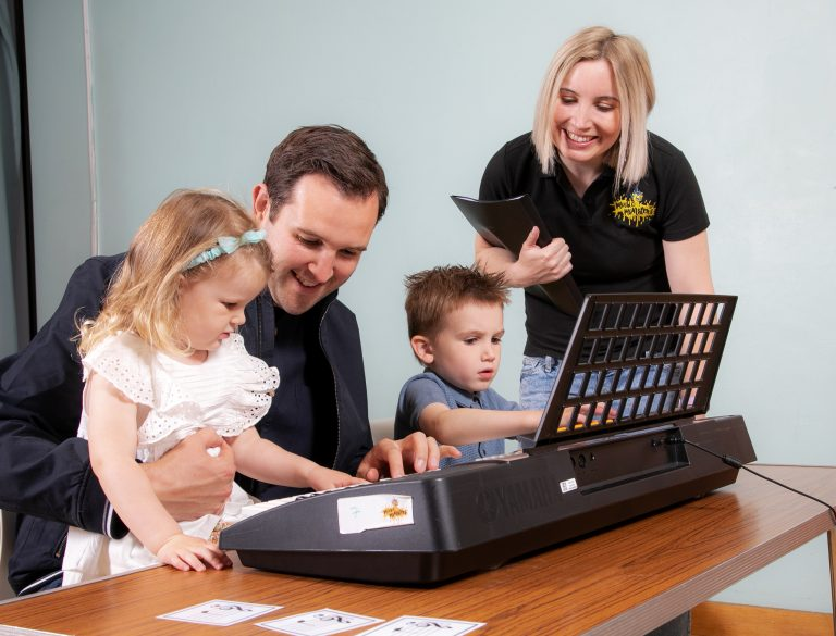 Parent with children at the keyboard